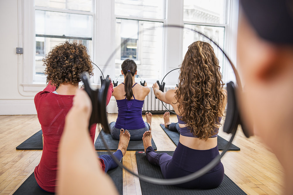 A pilates mat class at Core